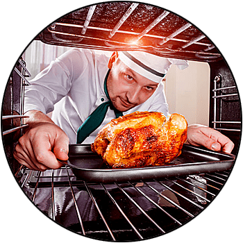 picture of male chef placing turkey into commercial oven