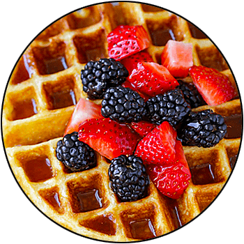 picture of a delicious Belgian waffle topped with fruit